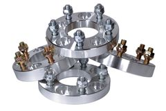 Wheel spacers made of light alloy at CNC lathe machine. Use to increase the wheelbase of the car. 25 and 20 millimeters, 114.3x5 f Stock Photography