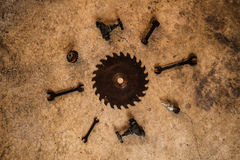 Metal tools, saw blade chisel wrench tap and drill bits laid flat on concre Royalty Free Stock Images