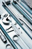 Metal tools on the scratched metal background Stock Images