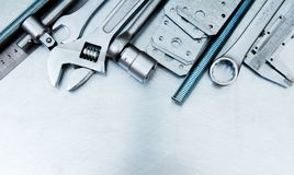 Metal tools on the scratched metal background Stock Photo