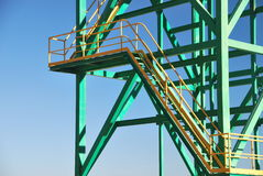 Metal tower close-up. Close-up of a mine tower stairway over a blue sky Royalty Free Stock Photos