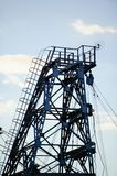 Metal tower of gas and oil extraction against the sky.  Stock Photo