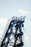 Metal tower of gas and oil extraction against the sky.  Royalty Free Stock Photo