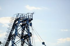 Metal tower of gas and oil extraction against the sky.  Stock Photos