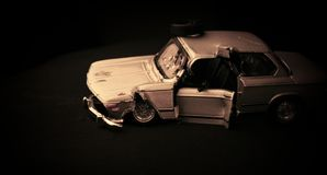 Old car wreck. Metal toy car wreck with low light Royalty Free Stock Photos