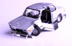 Old car wreck. Metal toy car wreck with white background Royalty Free Stock Photos