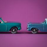 2 Metal toys in studio. With colourful background Royalty Free Stock Photography