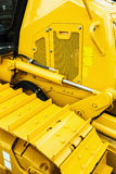 Metal tracks on the tractor. yellow Royalty Free Stock Images