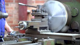 Metal trade. Milling machine operator working. Zoom out of turning lathe in action. Metal trade. Milling machine operator working in factory workshop. Zoom out stock video