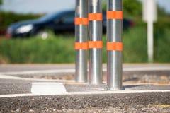 Metal traffic bollard for bike lane. Royalty Free Stock Photos