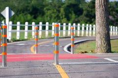 Metal traffic bollard for bike lane. Royalty Free Stock Photo