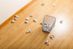 Metal trash bin and crumpled paper ball Stock Image