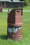 Metal trash can with bear proof lid. Vertical aspect Royalty Free Stock Photo