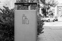 Metal trash can. In the city, photographed in Szeged,Hungary. Black and white photo Royalty Free Stock Image