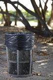 Metal trash can in the park Royalty Free Stock Image