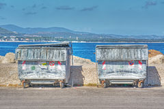 Metal trash containers by the shore Royalty Free Stock Photo