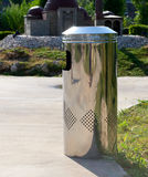 Metal trashcan in park Royalty Free Stock Image