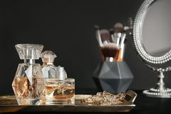Metal tray with perfume bottles. On dark background royalty free stock photography