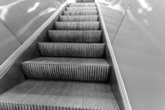 Metal treads on a moving escalator in a mall Royalty Free Stock Images