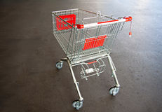 Metal trolley shopping basket at asphalt Stock Photography