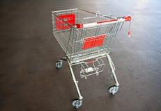 Metal trolley shopping basket at asphalt Stock Photography
