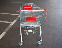 Metal trolley shopping basket at asphalt Stock Images