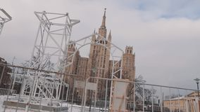 Metal trusses construction in front of Moscow State University covered in snow stock video