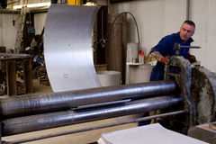 Metal tube fabrication. Making metal pipes and tubes in an engineering factory Stock Photos