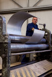 Metal tube fabrication. Making metal pipes and tubes in an engineering factory Stock Image