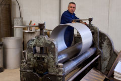 Metal tube fabrication. Making metal pipes and tubes in an engineering factory Royalty Free Stock Photo