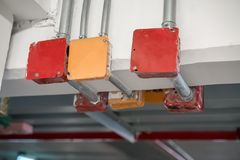 Metal tube pole or pipe clamp hanging on concrete ceiling holdin Stock Image