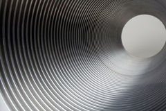 Metal Tunnel. Of metal tube showing light at end of tunnel Royalty Free Stock Photos