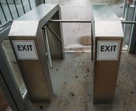 Metal Turnstile with inscription EXIT or urban Checkpoint close-up royalty free stock photos