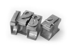Metal type (cast metal sort). A closeup of cast metal sorts for the numbers 1, 2, 3 and 4 Stock Photos