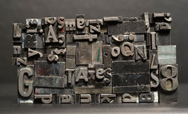 Metal Type Printing Press Typeset Taxes Typography Text Letters. Old metal blank printing press typeset all stacked up royalty free stock photography