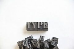 Metal type word with room for text. The word type in metal letters with a pile of assorted letters and numbers underneath stock photo