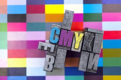 Metal types with cmyk with a proof royalty free stock images