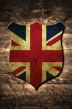 Metal United Kingdom shield. A metal United Kingdom shield on a wooden background Stock Photos