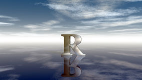 Metal uppercase letter r under cloudy sky Stock Photo