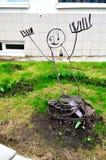 Metal urban unusual sculpture of iron man near Novgorod center of contemporary art in Veliky Novgorod, Russia Royalty Free Stock Photos
