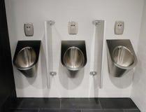 Metal urinals Stock Image