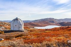 Metal US bunker and autumn greenlandic orange tundra landscape w Stock Photo