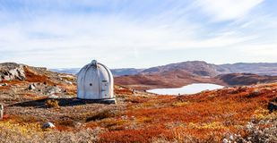Metal US bunker and autumn greenlandic orange tundra landscape w Stock Image