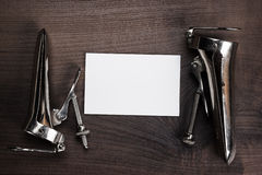 Metal vaginal speculums and blank notebook Stock Images
