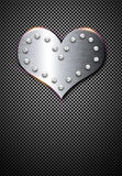 Metal valentine background with chrome heart Stock Images