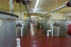Metal vats in bourbon distillery Royalty Free Stock Photo