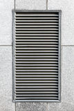 Metal ventilation grille in gray industrial wall. Close up photo texture Royalty Free Stock Photo