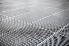 Metal ventilation grille on a sidewalk Stock Images