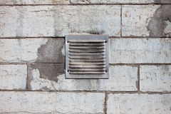 Metal ventilation window on wall background wall background Stock Photos