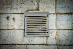 Metal ventilation window on wall background wall background. Metal ventilation window on old wall background Royalty Free Stock Photos